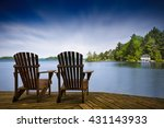 two muskoka chairs sitting on a ... | Shutterstock . vector #431143933