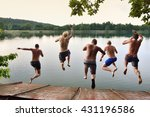 Happy young boys jumping together to the calm summer sea, adventure team photo on summer holiday or vacation, summer memories, original wallpaper full of happiness and energy