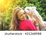 puppy white dog licking it's... | Shutterstock . vector #431268988
