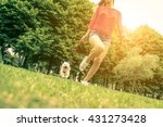 Stock photo young girl running with her dog puppy white dog is running with it s owner concept about 431273428