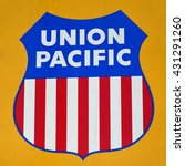 Small photo of BAKERSFIELD, CA - JUNE 2, 2016: The old and famous Union Pacific logo as it appears on the side of a diesel electric locomotive.