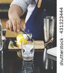 man makes cocktails  | Shutterstock . vector #431323444
