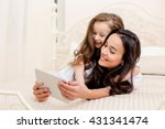 beautiful young mother and her ... | Shutterstock . vector #431341474
