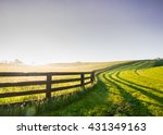 Horse Fence Snakes its Way Over the Hill in rural Kentucky - stock photo