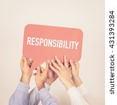 Small photo of A group of people holding the Responsibility written speech bubble