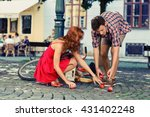 Small photo of man fell down from the bicycle and woman help him to collect products