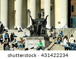 Small photo of New York City - March 7, 2006: Students sitting on the Columbia University Library steps next to the famed Alma Mater sculpture