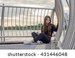 beautiful girl in a town near... | Shutterstock . vector #431446048