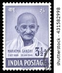 Small photo of London, UK, February 5 2012 - Vintage 1948 India cancelled airmail, postage stamp showing an engraved image of Mahatma Gandhi, issued to celebrate the first anniversary of India independence