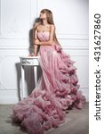 Stock photo creative portrait of a fashion woman in gorgeous long pink dress 431627860