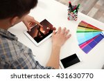 man working with color palette... | Shutterstock . vector #431630770