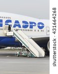 Small photo of MOSCOW, RUSSIA - SEPTEMBER 26, 2014: Boeing 747 waiting for passengers boarding. Transaero Airlines has ceased to exist in 2015.