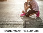 young lady tying laces for... | Shutterstock . vector #431685988