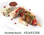 sausages on a skewer with pita...