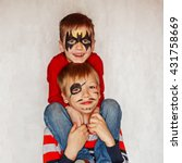 two boys with face art of a... | Shutterstock . vector #431758669