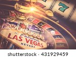 Las Vegas Gambling Concept. Roulette, Slot Machine and Las Vegas Welcoming Strip Sign. Playing in a Casino Conceptual Illustration. - stock photo