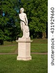 Small photo of Gatchina, Russia - June 1, 2016: Gatchina Palace. Sculpture in the Dutch garden. Allegory - Endeavour.
