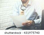 businessman looking through a... | Shutterstock . vector #431975740