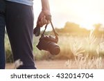 woman holding camera in hand on ... | Shutterstock . vector #432014704