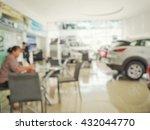 blurred photo of car showroom