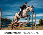 Stock photo horse rider in action under blue sky 432073276
