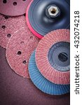 Small photo of Sanding wheels holder on polishing sheet abrasive tools.
