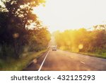 Asphalt Road At Sunset With...