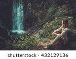 Beautiful Woman Hiker Sitting...