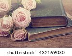 Roses On An Old Book In A...