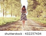 girl in dress on the summer road | Shutterstock . vector #432257434