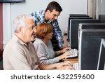 tutor assisting senior woman in ... | Shutterstock . vector #432259600