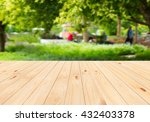 Wood Floor With Blurred Trees...
