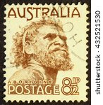 Small photo of Milan, Italy - December 18, 2013: australian postage stamp with a portrait of aboriginal.