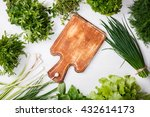 Various Fresh Herbs On A White...