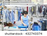 Worker Laundry Ironed Clothes...