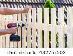 Building A Wooden Fence With A...