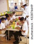 Stock photo primary school kids eat lunch in school cafeteria vertical 432876649