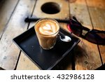 Small photo of Piccolo latte coffee, signature cup. A ristretto shot (15 – 20 ml) topped with warm, silky milk served in a 100 ml glass demitasse (small latte glass). Created by Aka Ama cafe, Chiangmai, Thailand.