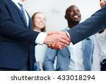 Business People Shaking Hands ...