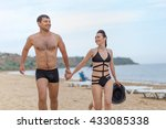 young couple on sand seashore...   Shutterstock . vector #433085338