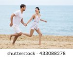 Barefoot Couple On Sand...