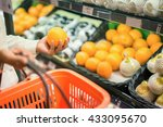 pick orange  female hand pick... | Shutterstock . vector #433095670