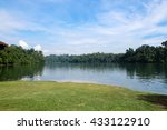 Lake And Forest Under Blue Sky...