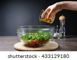 woman pouring olive oil on... | Shutterstock . vector #433129180