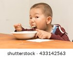 boy eats with gusto | Shutterstock . vector #433142563
