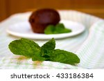 mint leaf and chocolate muffin... | Shutterstock . vector #433186384