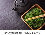 algae salad wakame with teapot | Shutterstock . vector #433211743