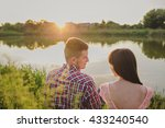 happy couple at a lake in the... | Shutterstock . vector #433240540