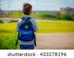 Little Boy With A Backpack Go...