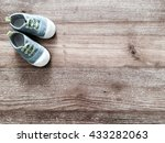 Stock photo cute little baby shoes on wood background top view 433282063